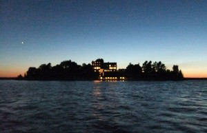 (SInger Castle at night from the water)